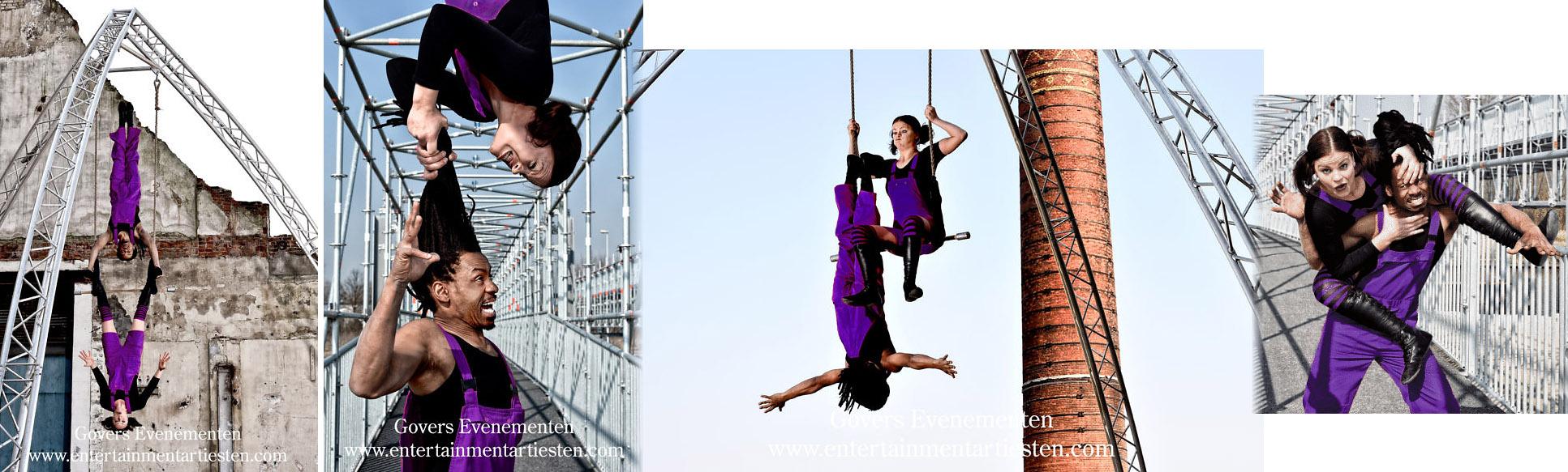 Luchtacrobatiek, Beleef weergaloze acrobatiek op de dunne lijn tussen vurige passie en blinde haat. Een cliffhanger van 15 minuten in een vrijstaande installatie voor binnen en buiten. Hoog, sensationeel en spannend tot op het eind; luchtacrobatiek op het scherpst van de snede, straattheater, acrobatiek, circusact, straattheater acts, artiesten boeken, artiestenbureau Govers Evenementen, lucht acrobatiek, festival act, voorstelling, www.goversartiesten.nl