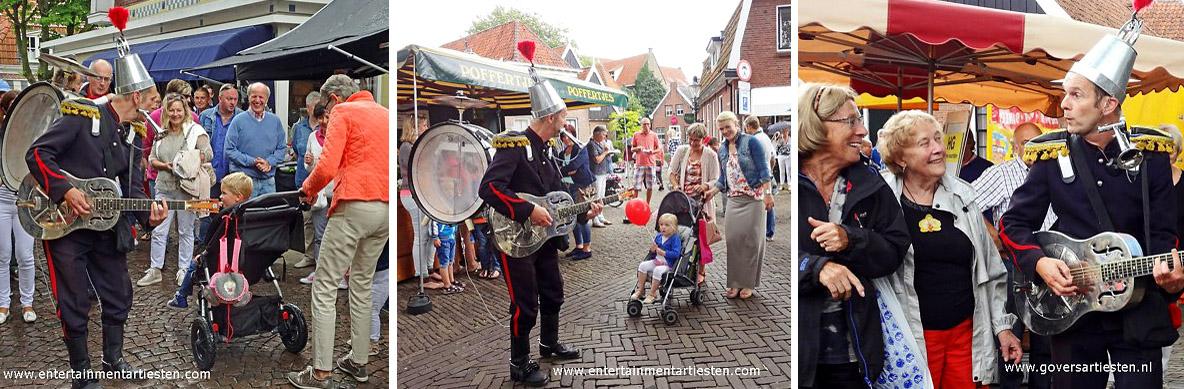 Winkelcentrum promotie activiteiten, Met gitaar, mondtoeter, rinkelende bellen en rugpercusie speelt de straatmuzikant Blikken Rik op pleinen en straten, Govers Evenementen, www.goversartiesten.nl